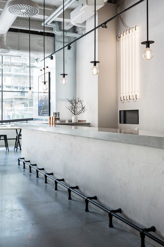 CATADOS - Mauricio Menezes  -  #mnz   -   concrete bar, neat pendant lights, also fluorescent line lights in back - love! Courtesy of Richard Lindvall