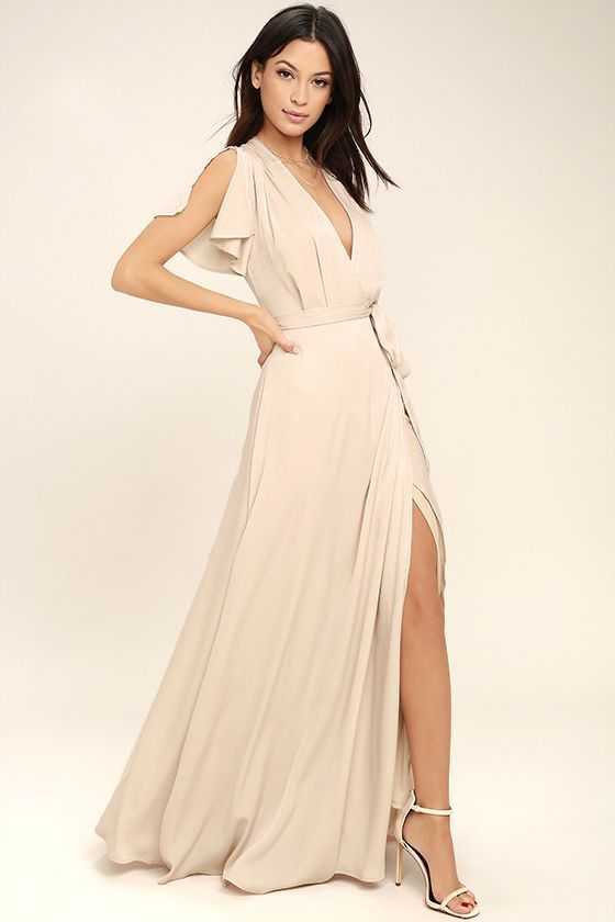 Lulus Exclusive! Gaze across the skyline in the City of Stars Nude Maxi Dress! Soft woven poly shapes a plunging surplice neckline and fluttering short sleeves. Fitted waist with tying sash tops a wrapping maxi skirt. Hidden back zipper/clasp.