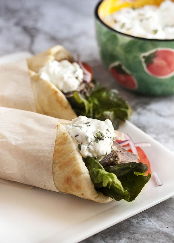 Leftover Lamb Gyros with Tzatziki Sauce - What to do with leftover lamb roast? Make these incredibly yummy lamb gyros and top them with a 5 minute tzatziki sauce. | justalittlebitofbacon.com Full recipe