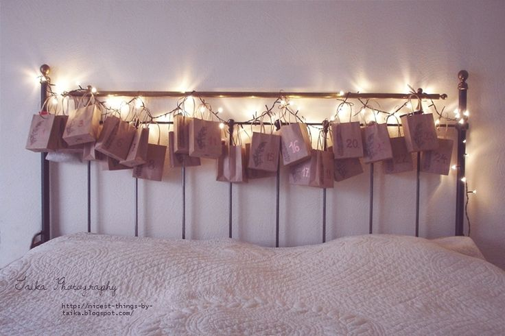 Advent Calendar countdown 30 days in December to Christmas. With fairy lights & paper bags for each day