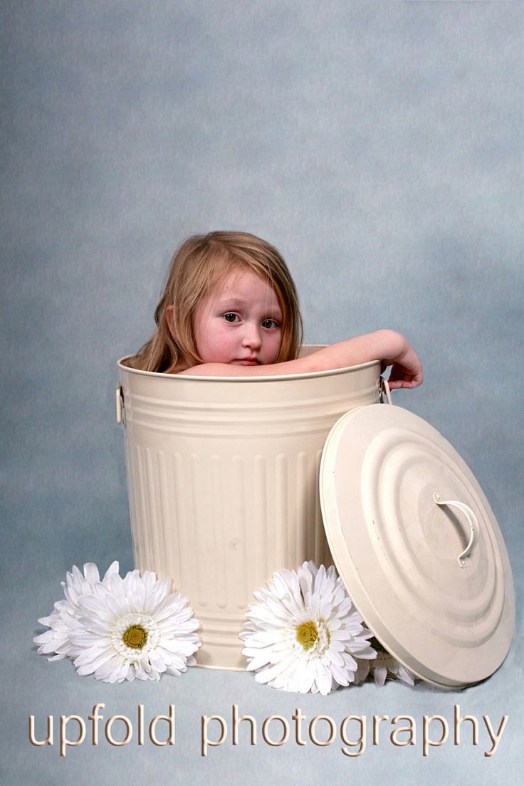 Cute! Full of trouble, sitting in a rubbish bin. Image by Upfold Photography, Auckland.