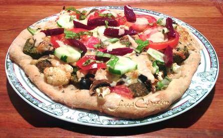 #Mediterranean #Pizza ... a #pizzadough dressed with toppings from around the Mediterranean Sea. We didn't ... but a little #Feta would have been a delight. We did use fresh toppings and #baked on a stone and fresh toppings just before serving! Free, Easy Recipes @ FoodCult.com - A Place for Galganov's Recipes and More - Food Matters!