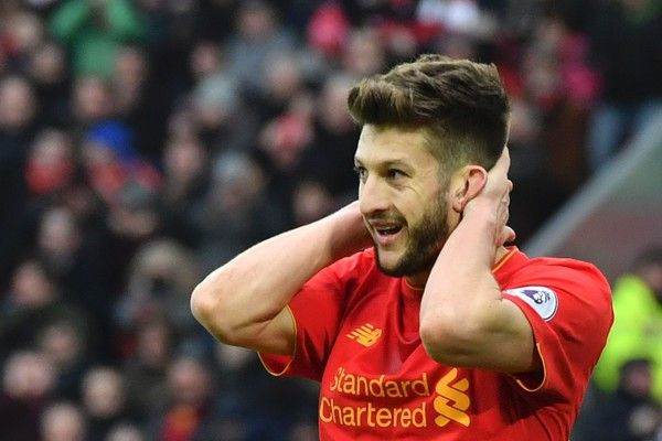 Liverpool's English midfielder Adam Lallana reacts after a missed chance during the English Premier League football match between Liverpool and Swansea City at Anfield in Liverpool, north west England on January 21, 2017. / AFP / Anthony DEVLIN / RESTRICTED TO EDITORIAL USE. No use with unauthorized audio, video, data, fixture lists, club/league logos or 'live' services. Online in-match use limited to 75 images, no video emulation. No use in betting, games or single club/league/player…