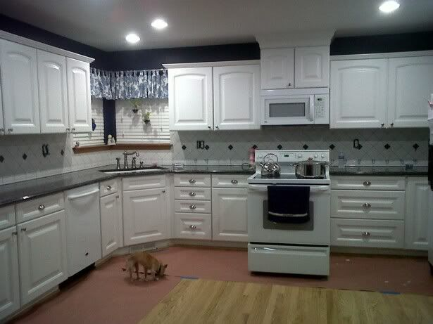 Possible backsplashes same countertop kitchen for White kitchen cabinets with blue pearl granite