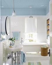 Give the ceiling a lift by covering it in beadboard and extending it down the walls a bit for a canopy effect. Paint it a tranquil shade of sky blue to evoke the porch ceilings of yore.  Similar to shown: 5½-inch-by-8-foot PVC beadboard panel, about $15; Lowe's. Paint: Benjamin Moore's Aura Bath & Spa paint in Sea Isle, about $70 per gallon; benjaminmoore.com