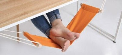 Under Desk Foot Hammock This one is more of a luxury than a necessity but that doesn't stop us wanting it all the same! Who wouldn't want to put their feet up while they're sitting at their desk?