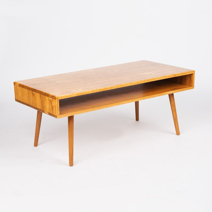 Hand-built and mid-century modern Bauhaus inspired table is made of solid pine and has tapered legs that have been hand cut and angled to inspire that significant 1950's T.V. modern look. Hand-stained ...  Find the Bauhaus Pine Coffee Table, as seen in the Coffee Tables Collection at http://dotandbo.com/category/furniture/tables/coffee-tables?utm_source=pinterest&utm_medium=organic&db_sku=ORW0005-walnut
