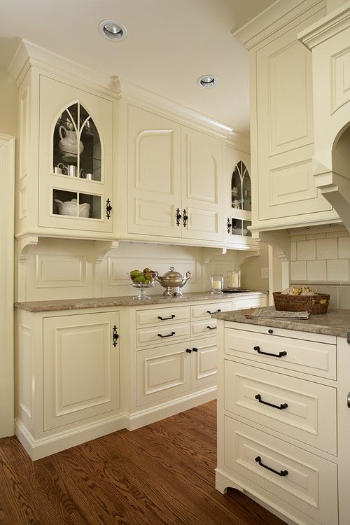 love the cream-colored cabinets and the countertops.    This is like a built-in china cabinet.   You could take a second hand china cabinet and paint it just like this.