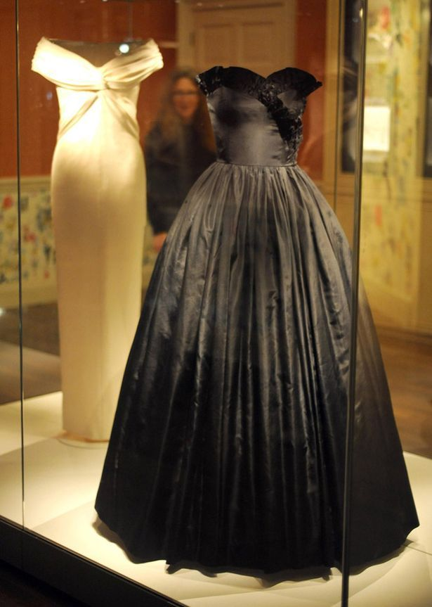 Two of Princess Diana's dresses, a classic formal dinner dress by Catherine Walker and a black silk taffeta gown by Emanuel