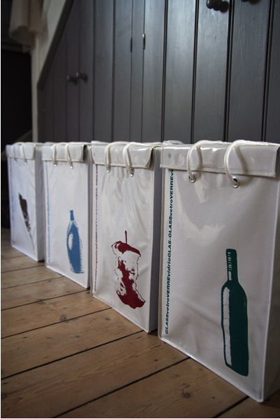 silk screen recycling bins - they take up a lot of floor space though... would love to hang them somehow or similiar aesthetic on hanging bins.