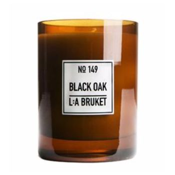 L:A Bruket Large Scented Candle: Black Oak: The fragrance of L:A Bruket's Black Oak Candle is designed to take your 21st century heart and soul back to the wilds where you will find strength and calm. The rich scent of Nordic woods - blackened oak, birch and cashmere wood - produces a powerful, natural aroma and and a totally unique ambience for your home.  L:A BRUKET scented candles are all made from organic soy wax and hand poured into mouth blown glasses by skilled craftsmen.