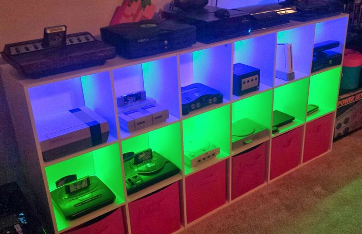 Video Game Console Shelves with colored lighting. Via Reddit user BishSticks