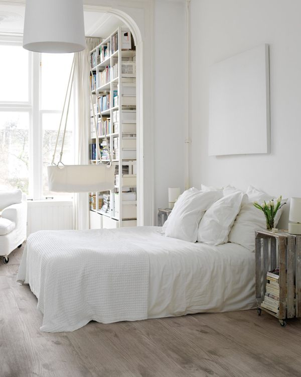 I love everything about this bedroom! The nightstands, lamp, floors, bookcase, everything.