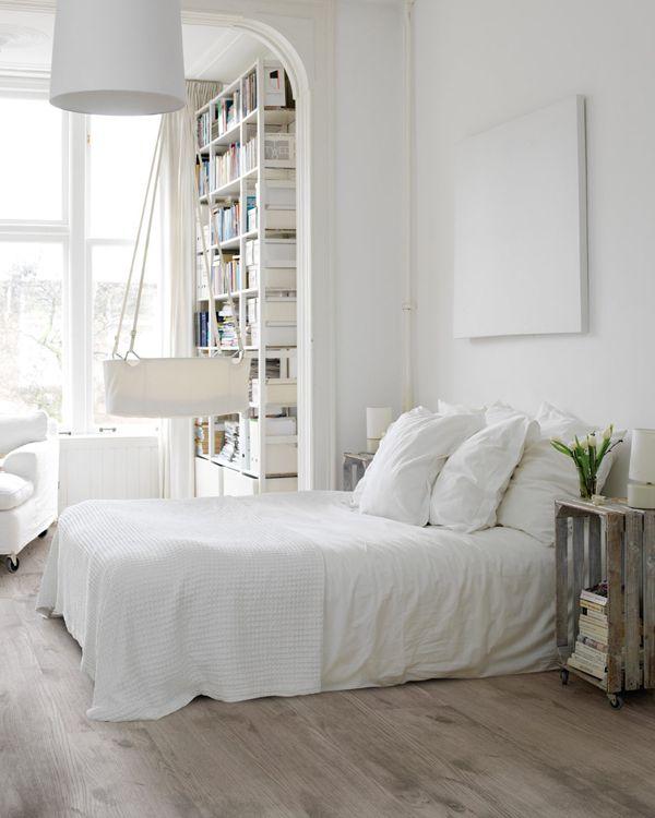Scandinavian bedroom...that bed looks wicked comfy.