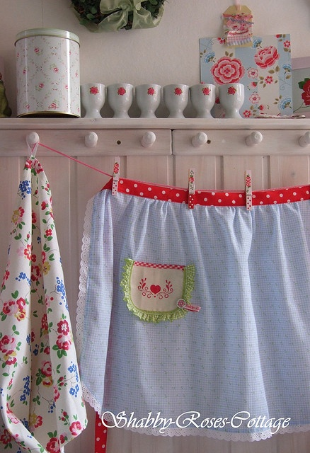 Apron love - wouldn't this be cute as a half window curtain above the sink?