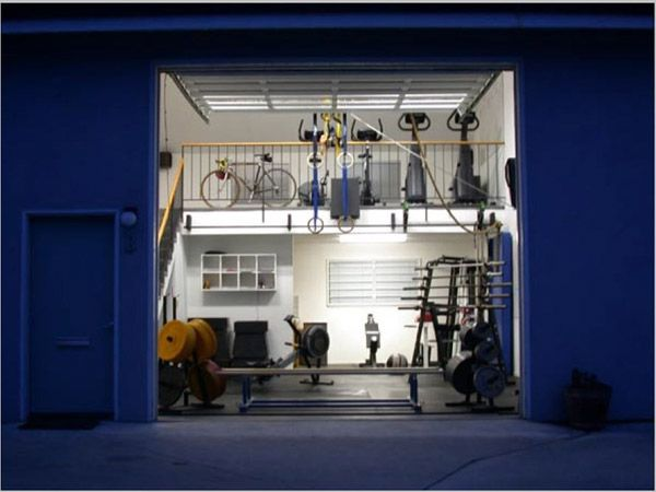 Amazing two tier garage gym with all the right exercise
