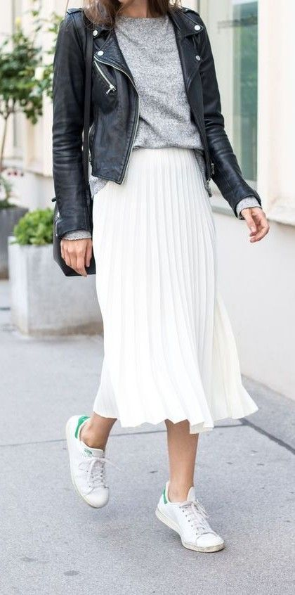 white pleated skirt. leather jacket. #streetstyle