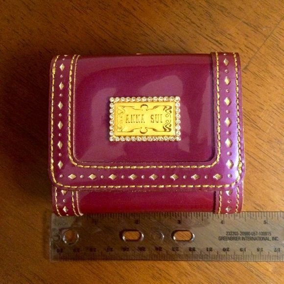 Anna Sui wallet Fun funky petite wallet by Anna Sui is rare and one of a kind. The wallet is tri-fold with metal clasps coin purse. This wallet is pre-owned but in mint conditions. There are no marks or stain on the leather insides.   See scale for wallet size. Anna Sui Bags Wallets