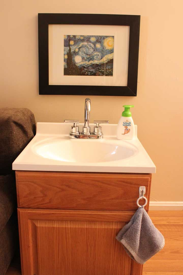 hand washing basin in a Montessori home (see post for details on how her husband made this work)