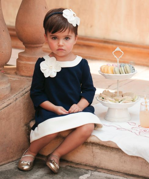 Dress your little lady in our timeless ponte dress accented with a striking corsage flower.