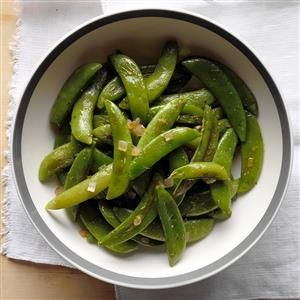 Roasted Sugar Snap Peas Recipe -We're betting you won't find a faster way to dress up crisp sugar snap peas than this simply scrumptious recipe from our Test Kitchen. It goes with a variety of entrees and is pretty enough to dish up for company.