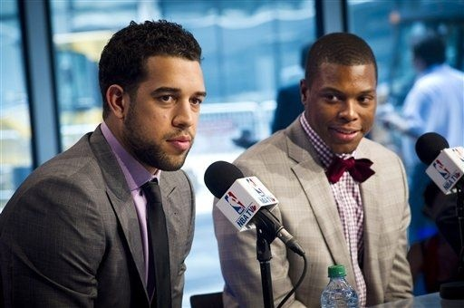 Toronto Raptors new NBA basketball players Landry Fields, left, and Kyle Lowry look on during a news conference in Toronto, Tuesday, July 17, 2012. Lowry was acquired last week in a trade with the Houston Rockets. Fields was signed after the New York Knicks chose to not match Toronto's offer sheet for the restricted free agent. (AP Photo/The Canadian Press, Ian Willms)