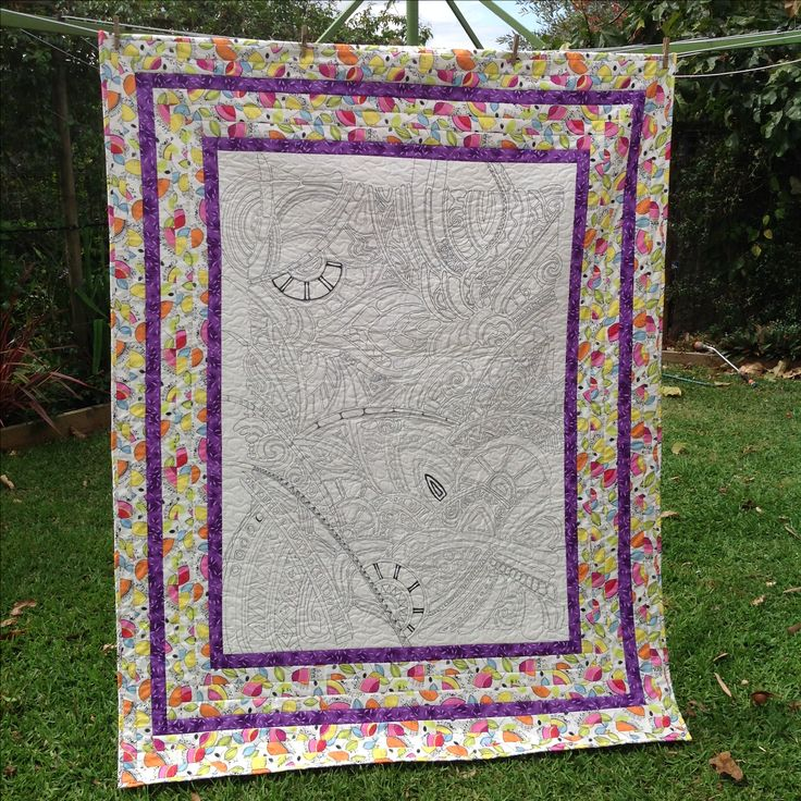 Girls colouring in quilt with room for more doodling. Permission to colour in the quilt and make it their own!