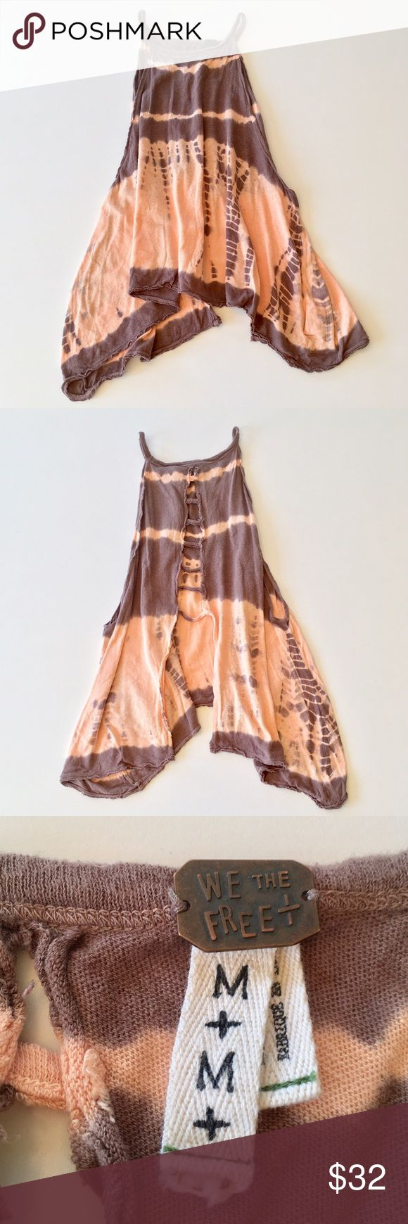 """We The Free Bonfire Tank Style: Tie dye design, high neck, split open back, oversized armholes, raw hem, cropped asymmetrical length. Measurements: ≈20-25"""" length; ≈7"""" strap to strap. Color: Taupe/Peach. Fabric: 52% Linen, 48% Cotton. Condition: Pre-owned with slight wear and a few loose threads; otherwise great condition. Care: Hand wash cold. Free People Tops Tank Tops"""