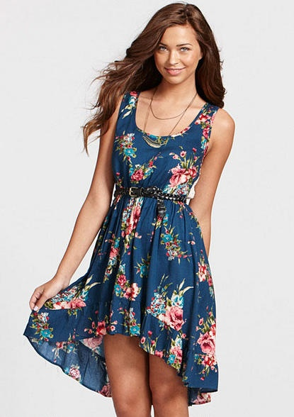 Sleeveless allover floral dress with crochet back and high-low detail. Removable/adjustable belt for better fit.
