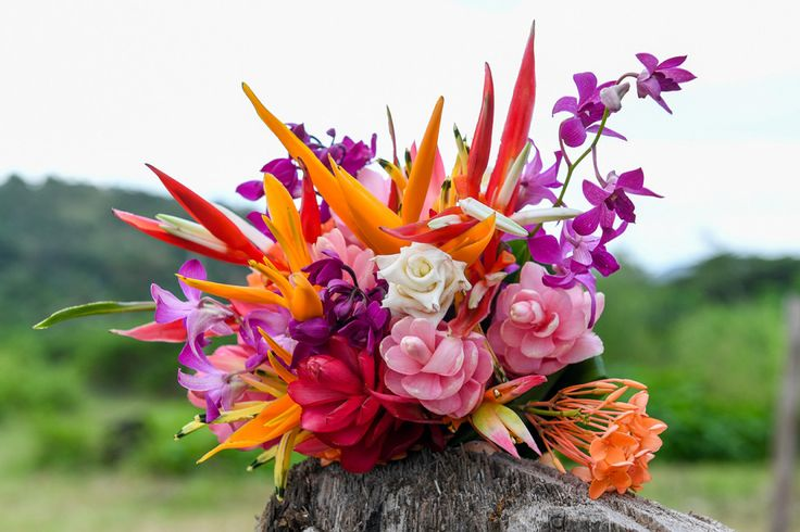 The bride's bouquet made of colorfull tropical flowers at the Warwick, Fiji. Photographed by Anais Photography.