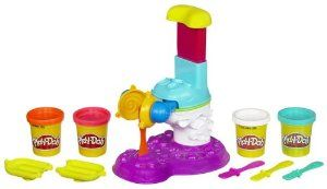 """Sweets Café Perfect Pop Maker Playset by Play-Doh. $9.49. Playset comes with ice pop mold, lollipop mold, 4 ice pop sticks and 4 two-ounce cans of Play-Doh modeling compound. Use the 4 colors of Play-Doh modeling compound to make brightly colored """"treats"""". With the 4 included colors of Play-Doh modeling compound, your """"ice pops"""" and """"lollipops"""" can be blue and pink, orange and white, or all 4 colors at once. Make your pretend treats, then start all over with new creations...."""