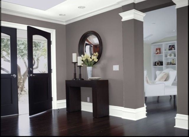 Dark floors + white trim + gray walls + dark doors = perfect home! But maybe a little less of brown tone to it. I'd like more of a true gray!