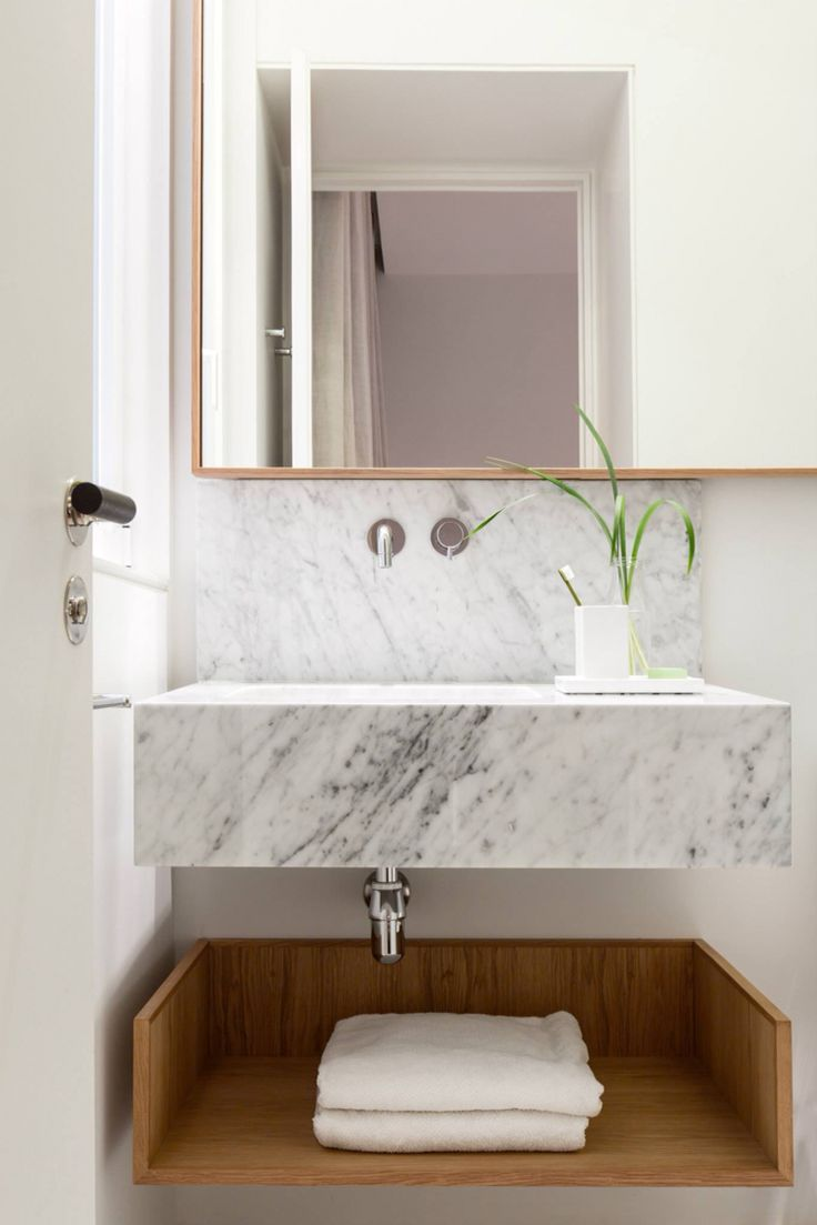 Scandinavian,interiors,design,modern, bathroom with white marble sink and  wood shelf