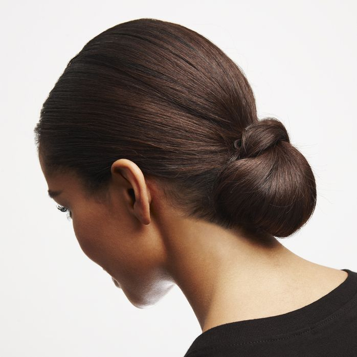 How to get a chic chignon: A sophisticated, sleek bun for a New Years Eve party.