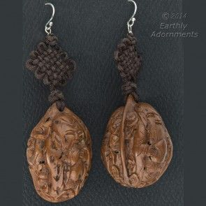 Vintage earrings of old Chinese carved walnuts hanging from a Chinese  Feng knot.