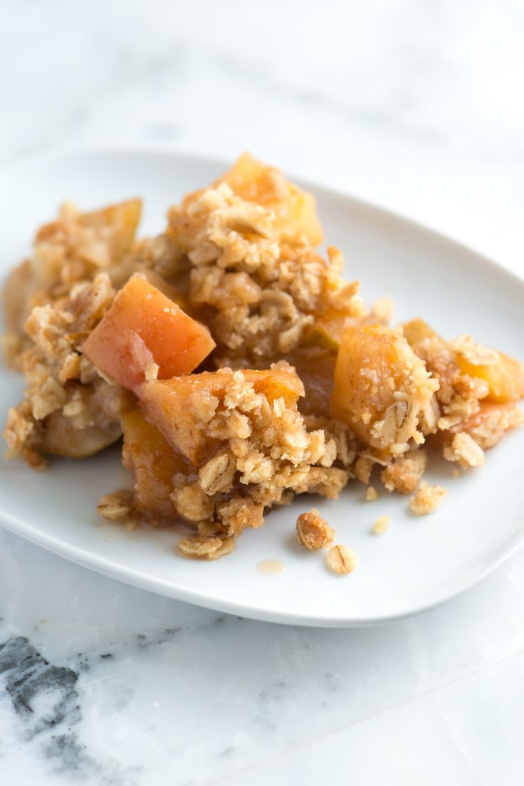 This apple crisp recipe with oats has sweet tender apples and a crisp and crunchy topping made with flour, oats, brown sugar, butter and cinnamon