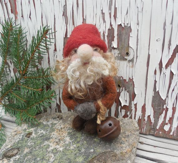 A funny little Scandinavian Tomte holds a cute rustic harness bell. Needle felted with soft wool roving in browns, gray, and rust, with curly wool locks for his hair and beard. Hang him on your Christmas tree, wreath, or set him on your mantel. He is perfect for Scandinavian and woodland themed holiday decor!  Measuring 6 inches tall with a clear monofilament hanger, he will come in his own special box for easy storage and gift giving