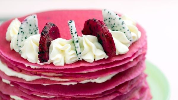 Recipe with video instructions: Thin layers of perfectly airy crepes are naturally colored with dragon fruit for a bright and colorful take on a yummy dessert. Ingredients: For the crepe batter:, 1 cup dragon fruit puree (about 2 dragon fruits, see below), 1 1/2 cups all-purpose flour, 1/4 cup granulated sugar, 1/2 teaspoon salt, 1 1/2 to 2 cups whole milk, 4 large eggs, 1 tablespoon vanilla extract, Cooking spray, For the whipped cream:, 8 ounces mascarpone, room temperat...