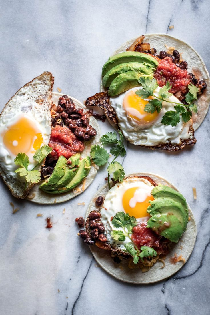 This breakfast taco is made with chipotle black beans, sautéed onion and bell pepper, skillet-fried egg, avocado slices, salsa and cilantro. YES please!