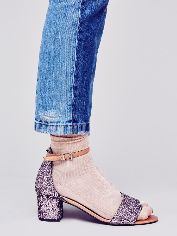 Glitter Marigold Block Heel | With eye-catching glitter allover, this stunning metallic sandal features a chunky block heel for a cute and comfortable step. Delicate ankle strap detail is adjustable for the perfect fit. Padded footbed for support.