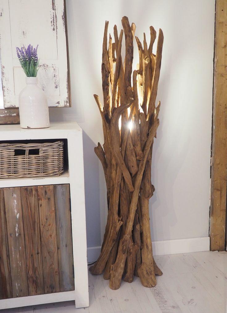 This rustic driftwood effect floor spotlight will