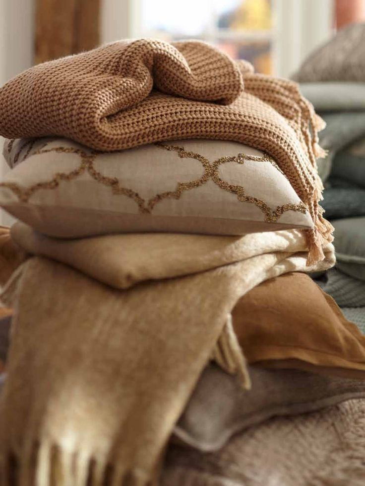 Pile on the pillows! #potterybarn and don't forget to throw in a throw!   For the Fall or Winter months.