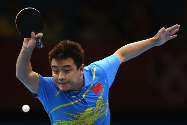 Wang Hao of China plays a shot during Men's Singles Table Tennis Gold medal match against Zhang Jike of China on Day 6 of the London 2012 Olympic Games at ExCeL on August 2, 2012 in London, England. (Photo by Feng Li/Getty Images)