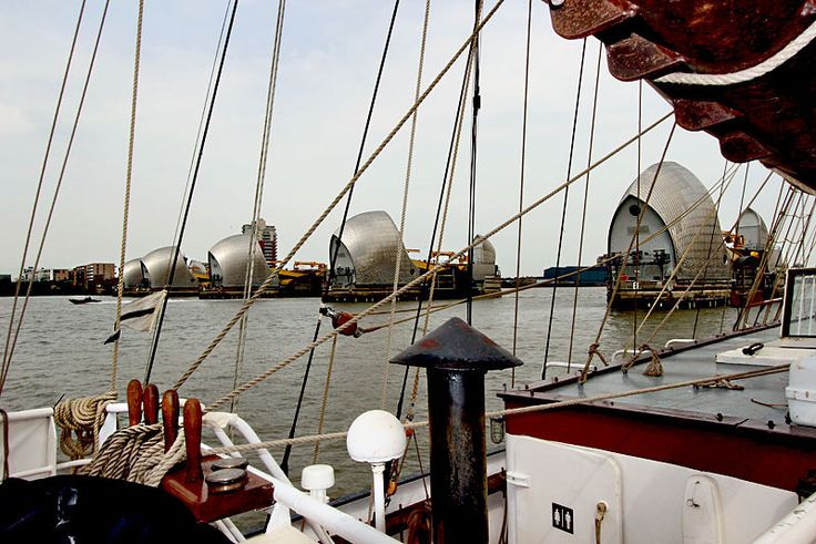 A tall ship out of London's Greenwich sails through the Thames Barrier on the River Thames