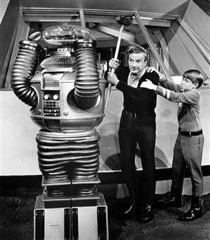 LOST IN SPACE...airing between September 15, 1965, and March 6, 1968.  Danger Will Robinson!  I loved this show.