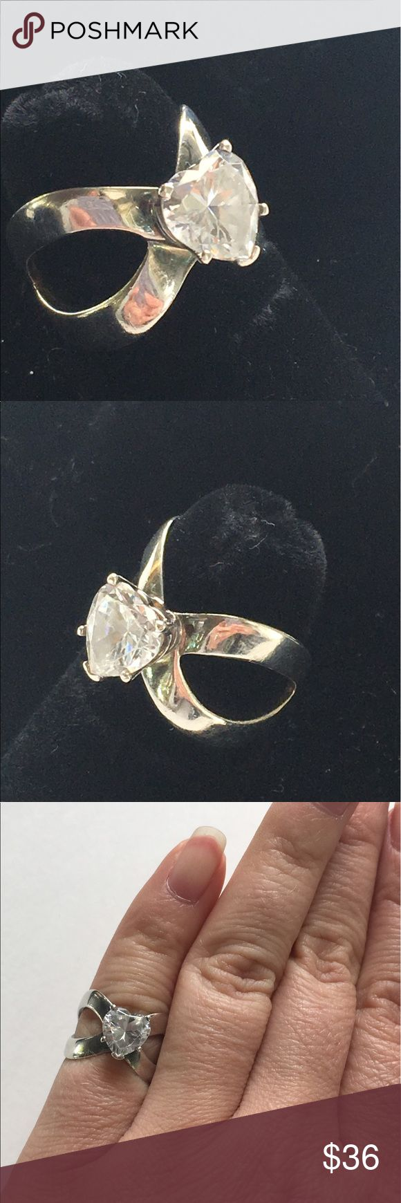 Heart shaped CZ ring Sterling silver vintage A beautiful ring with a heart shaped CZ stone on open band. The styling on this is so stunning! It would make a great affordable engagement ring option. Stamped 925 CZ. Overall good used condition showing light signs of use. Approx size 5. Sorry NO TRADES! Vintage Jewelry Rings