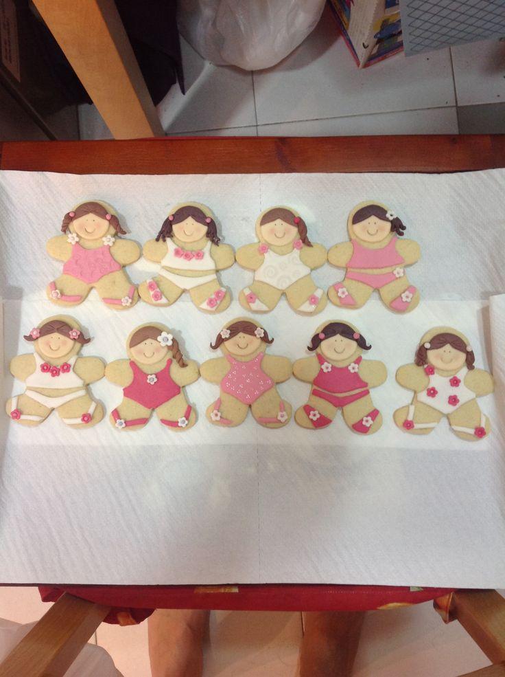 Girls in swimsuit. Sugar cookies summer holidays.
