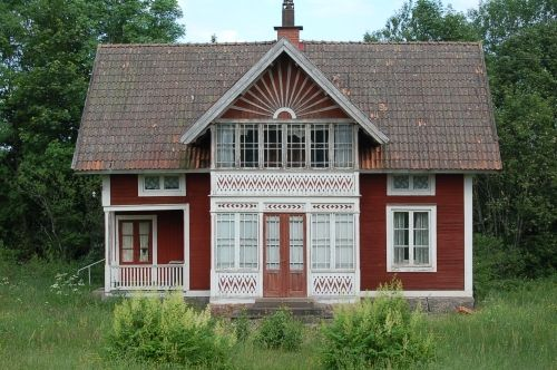 "This old Swedish house has a lot of wooden details. In Swedish they talk about ""snickarglädje"" or the fun the carpenter had while making these wooden details."