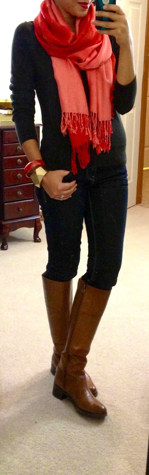 Black sweater and skinnies, brown riding boots, melon ombré scarf