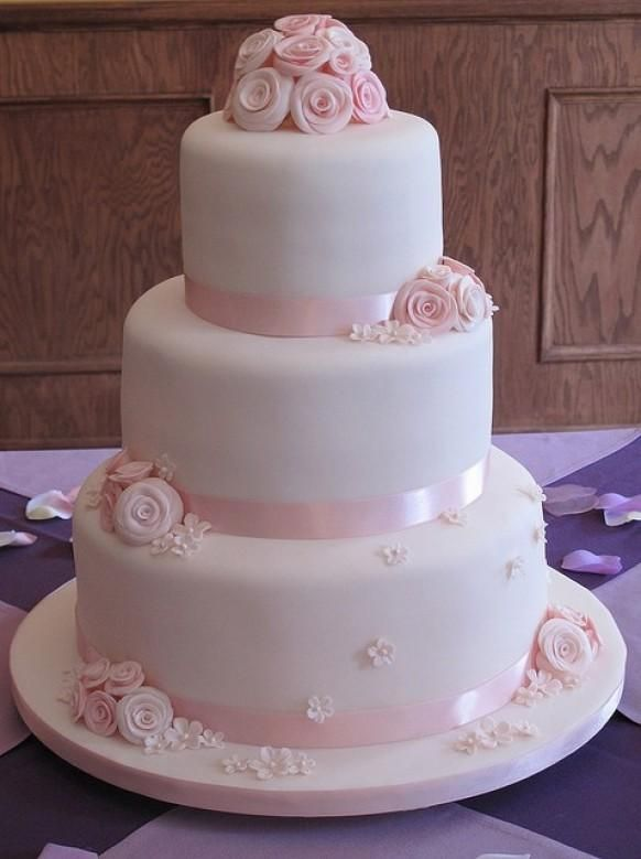 Weddbook ♥ Pale pink fondant wedding cakes with perfect sugar roses. 3 tier wedding cake. tier pink pale rose fondant